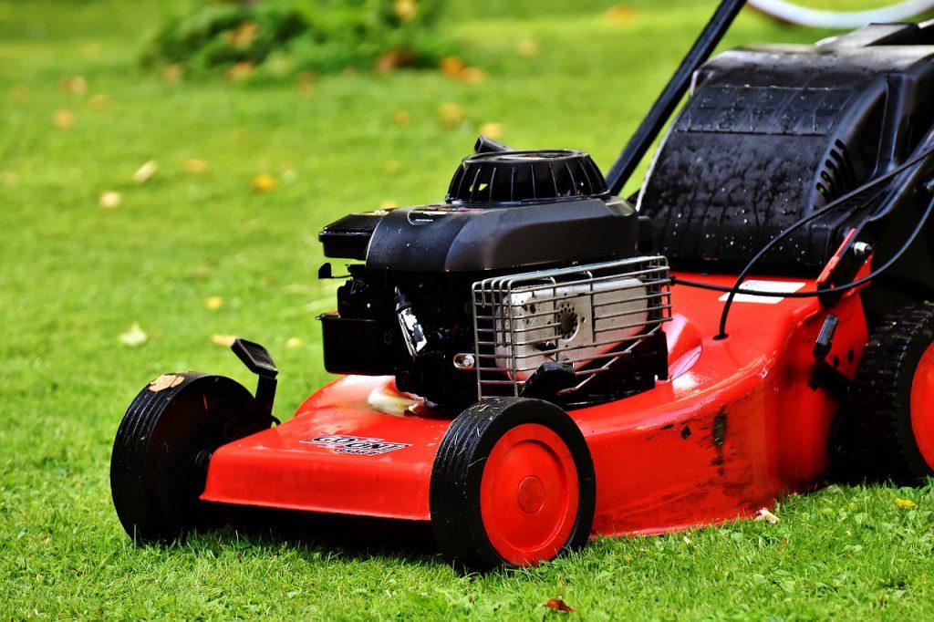 Gardener using a lawn mower in Torquay